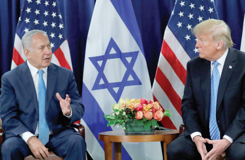 Prime Minister Benjamin Netanyahu meets US President Donald Trump; Psychology Prof. Shaul Kimhi of Tel Hai College notes Netanyahu's 'ability to mobilize his supporters,' a trait he says that also characterizes Trump (photo credit: CARLOS BARRIA / REUTERS)