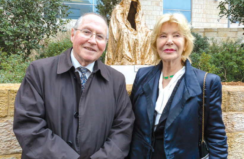 'CLOAK OF Conscience': Former deputy president of the Supreme Court Elyakim Rubinstein and artist Anna Chromy stand in front of the newly inaugurated sculpture. (photo credit: ELISHA EVEN-TOV)