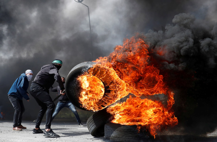 Palestinian rioters in clashes near Ramallah (REUTERS/Mohamad Torokman) (photo credit: REUTERS/MOHAMAD TOROKMAN)