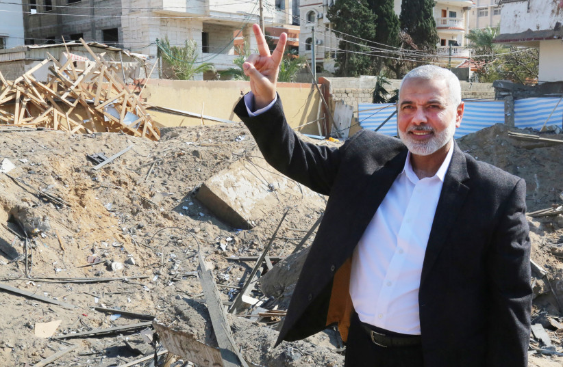 Hamas chief Ismail Haniyeh next to his destroyed office (REUTERS/Handout) (photo credit: HANDOUT/REUTERS)