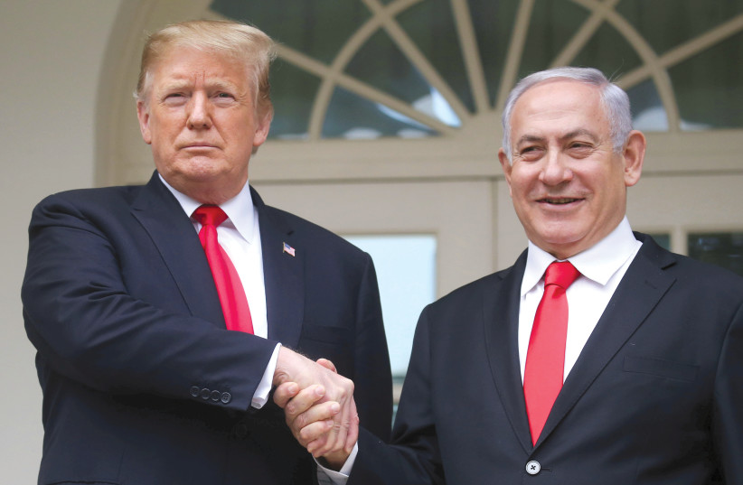 US PRESIDENT Donald Trump shakes hands with Prime Minister Benjamin Netanyahu as they pose in the Rose Garden at the White House this week (photo credit: REUTERS/LEAH MILLIS)
