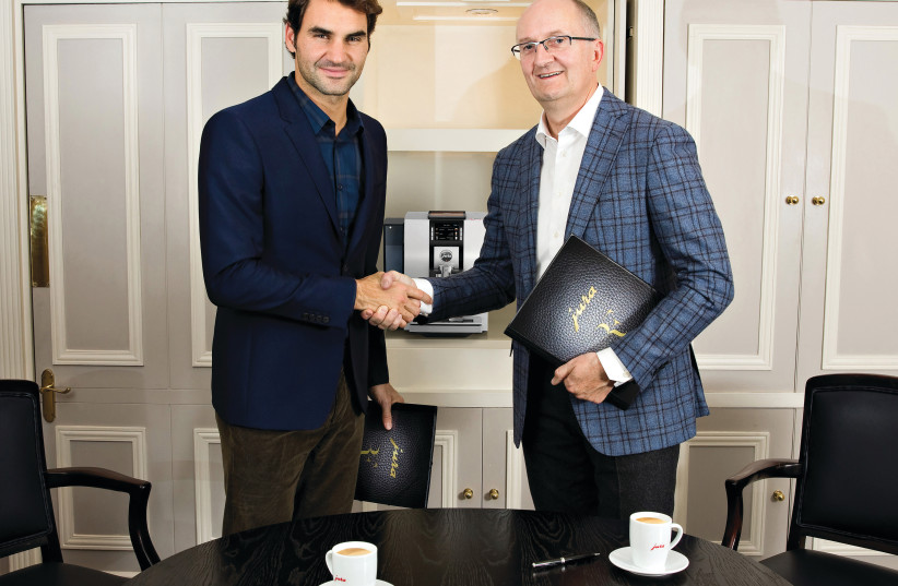 ROGER FEDERER and Jura CEO Emanuel Probst after the signing of the contract (photo credit: Courtesy)