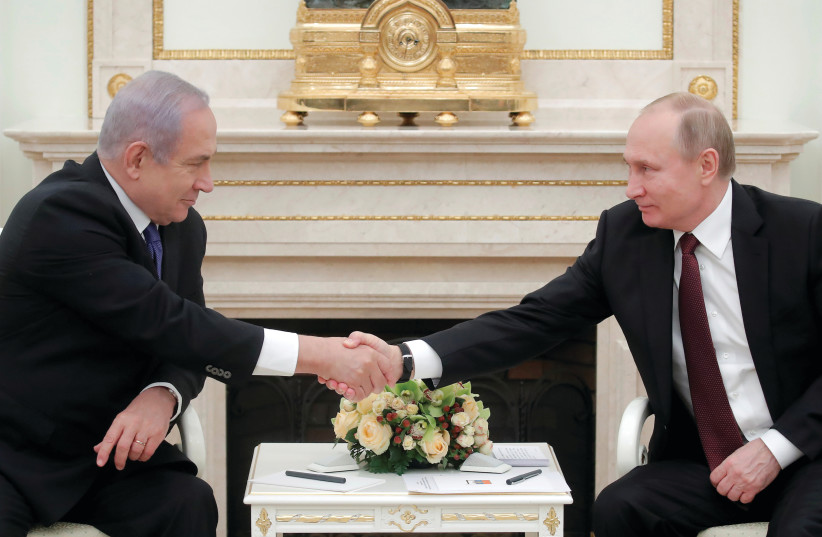 RUSSIAN PRESIDENT Vladimir Putin shakes hands with Prime Minister Benjamin Netanyahu during a meeting in Moscow last month. (photo credit: REUTERS)