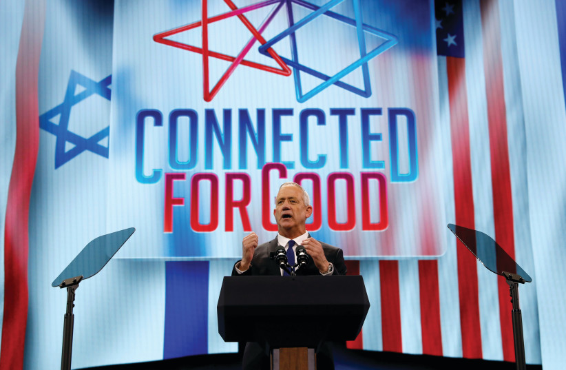 BLUE AND WHITE leader Benny Gantz addresses the AIPAC Policy Conference on Monday.  (photo credit: REUTERS)