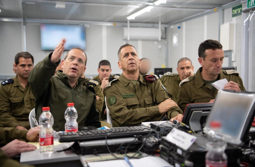 IDF Chief of Staff Aviv Kochavi surrounded by high-ranking officers as they prepare for escalations along the Gaza border, 2019. (photo credit: IDF SPOKESPERSON'S UNIT)