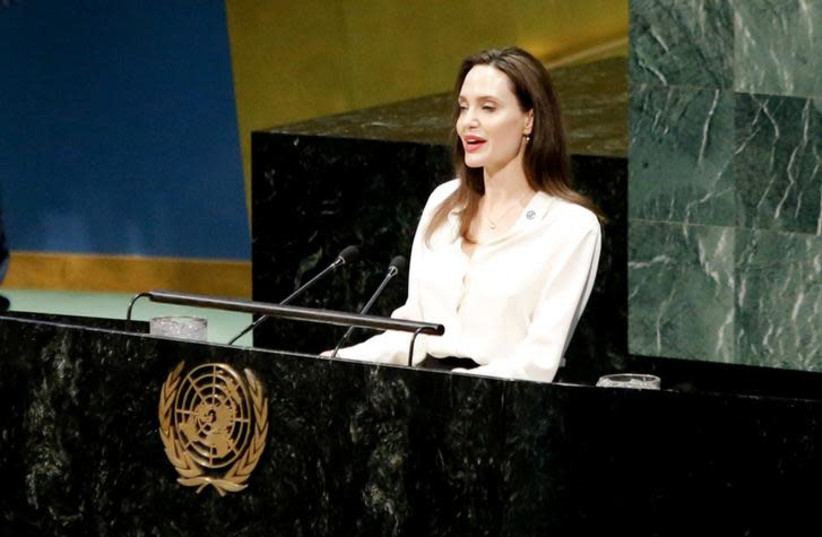 Actor and UNHCR Special Envoy Angelina Jolie addresses a U.N. ministerial meeting on peacekeeping at U.N. headquarters in New York, U.S., March 29, 2019 (photo credit: REUTERS/EDUARDO MUNOZ)