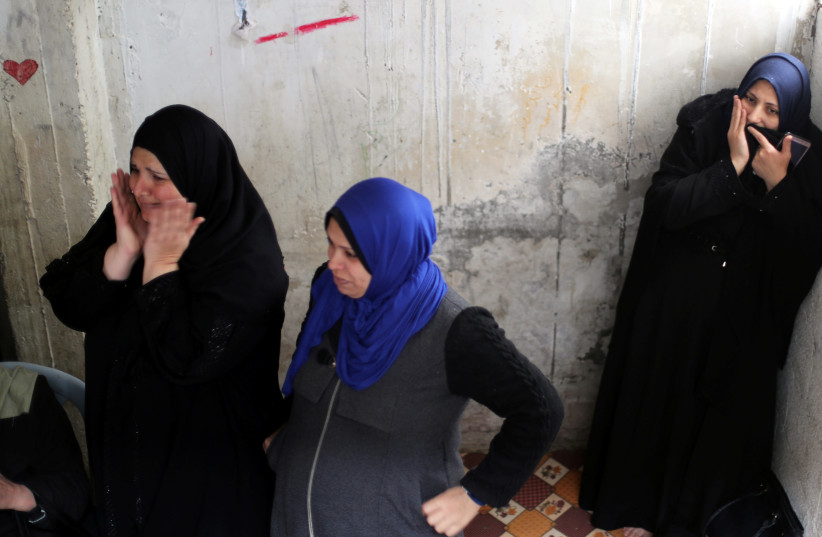 Relatives of Palestinian Mohamad Sa'ad, who was killed at the Israel-Gaza border, react during his funeral in Gaza City March 30, 2019. (photo credit: MOHAMMED SALEM/ REUTERS)