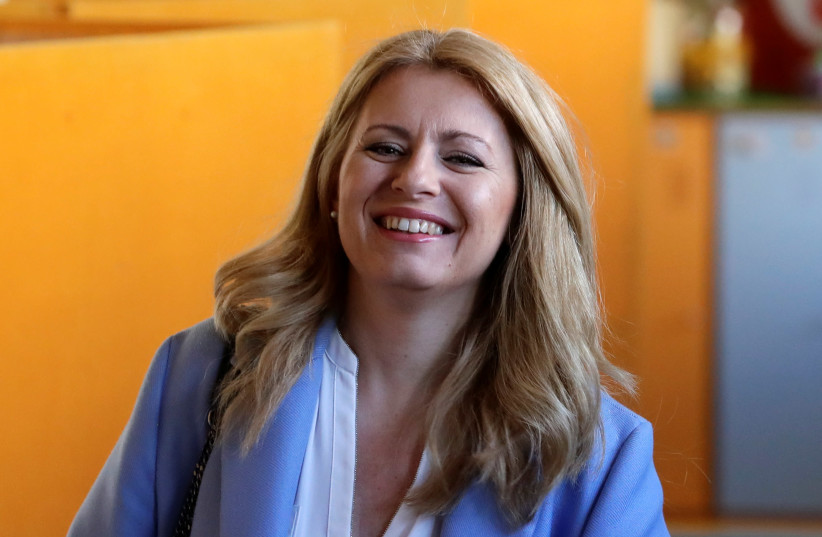Slovakia's President-elect Zuzana Caputova reacts as she casts her vote during the country's presidential election run-off, at a polling station in Pezinok, Slovakia, March 30, 201  (photo credit: DAVID W. CERNY / REUTERS)