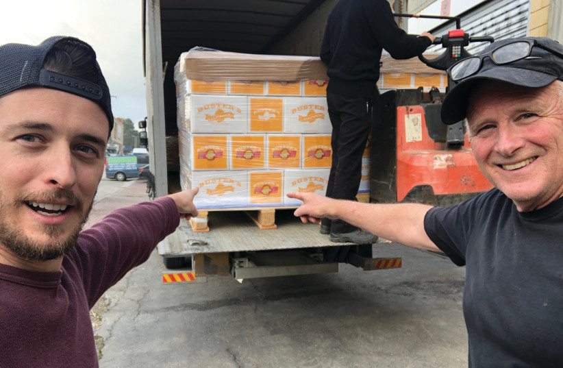 MATT NEILSON (left) and Denny Neilson with the first shipment of ciders and lemonades leaving for America (photo credit: Courtesy)