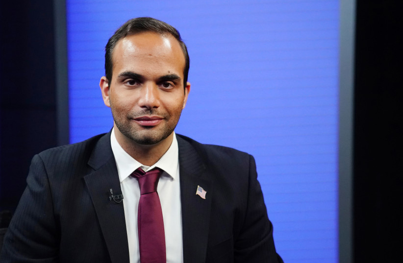 George Papadopoulos, a former member of the foreign policy panel to Donald Trump's 2016 presidential campaign, poses for a photo before a TV interview in New York, New York, U.S., March 26, 2019 (photo credit: REUTERS/CARLO ALLEGRI)