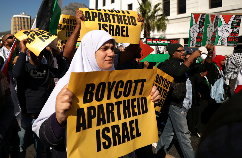 Protestors call for the severing of diplomatic ties with Israel during a march in Cape Town, South Africa, May 15, 2018 (photo credit: REUTERS/MIKE HUTCHINGS)