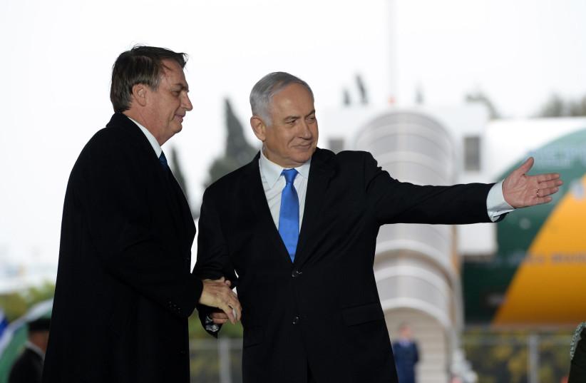 Prime Minister Benjamin Netanyahu received Brazilian President Jair Bolsonaro at Ben Gurion Airport on March 31, 2019 (photo credit: HAIM ZACH/GPO)