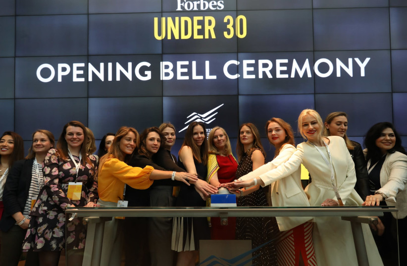 Forbes Under 30 Global Women's Summit participants open the trading at Tel Aviv Stock Exchange, March 31, 2019  (photo credit: OMER MESSINGER)
