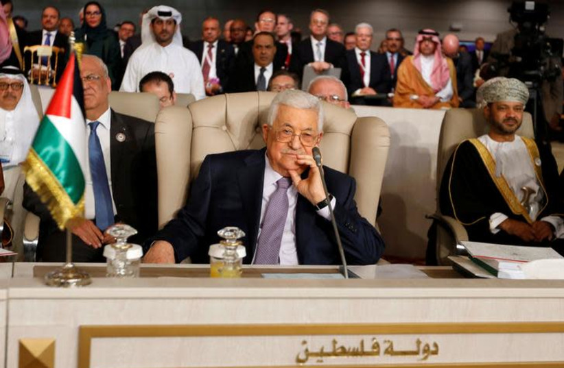 Palestinian President Mahmoud Abbas attends the 30th Arab Summit in Tunis, Tunisia March 31, 2019 (photo credit: REUTERS/ZOUBEIR SOUISSI)
