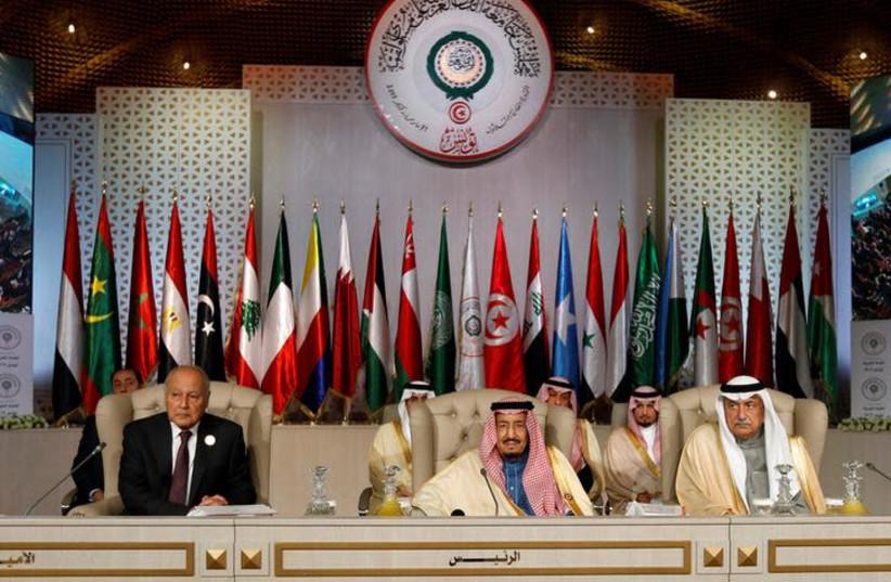 Arab League Secretary-General Ahmed Abul Gheit, Saudi Arabia's King Salman bin Abdulaziz and Saudi Arabia's Foreign Minister Ibrahim al-Assaf attend the 30th Arab Summit in Tunis, Tunisia March 31, 2019 (photo credit: ZOUBEIR SOUISSI / REUTERS)