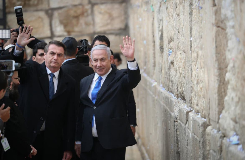 Brazilian President Jair Bolsonaro [L] and Prime Minister Benjamin Netanyahu [R] at the Western Wall.   (photo credit: YONATHAN SINDEL/FLASH90)