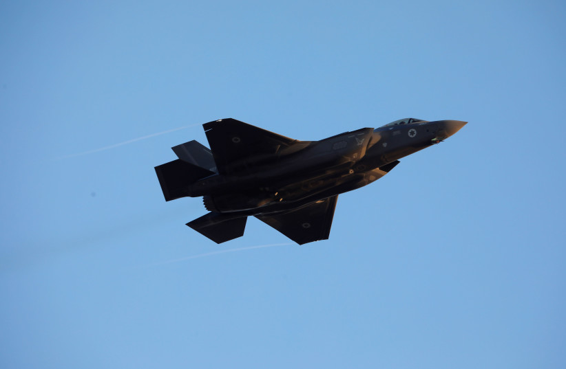 Israeli Air Force F-35 flies during an aerial demonstration at a graduation ceremony for Israeli air force pilots at the Hatzerim air base in southern Israel December 26, 2018.  (photo credit: AMIR COHEN/REUTERS)