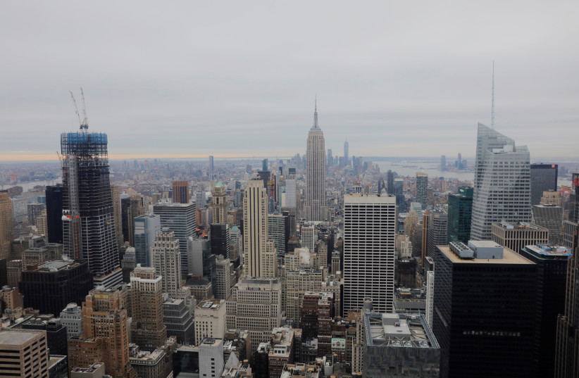 The Empire State Building rises above New York, U.S., January 23, 2019 (photo credit: REUTERS/LUCAS JACKSON)