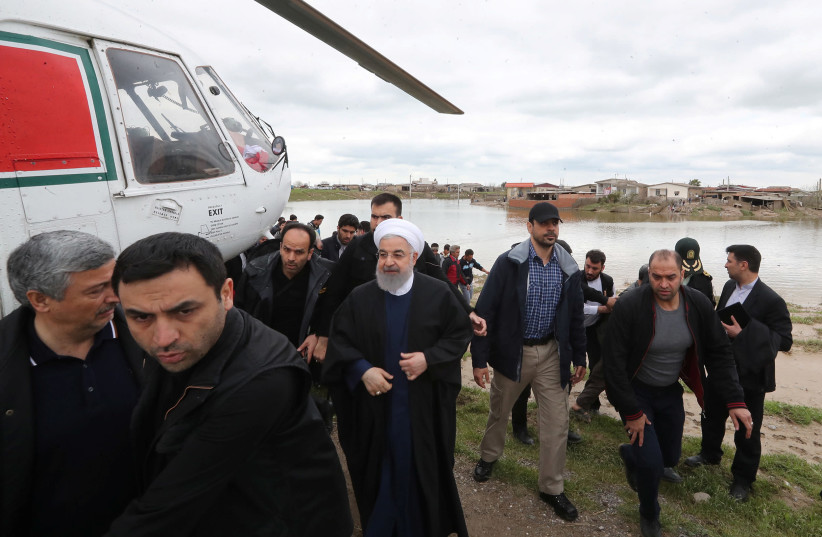 Iranian President Hassan Rouhani is seen during his visit after flooding in Golestan province, Iran March 27, 2019 (photo credit: IRANIAN PRESIDENCY WEBSITE/HANDOUT VIA REUTERS)
