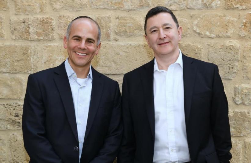 DLA Piper Co-CEO Simon Levine and Israel practice head Jeremy Lustman (photo credit: ISRAEL HADARI)