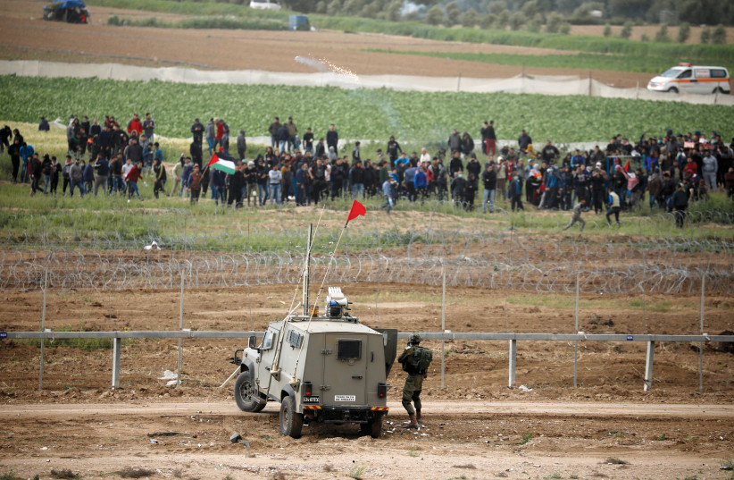 GAZAN PROTESTERS at the border fence on Saturday. (Reuters) (photo credit: REUTERS)