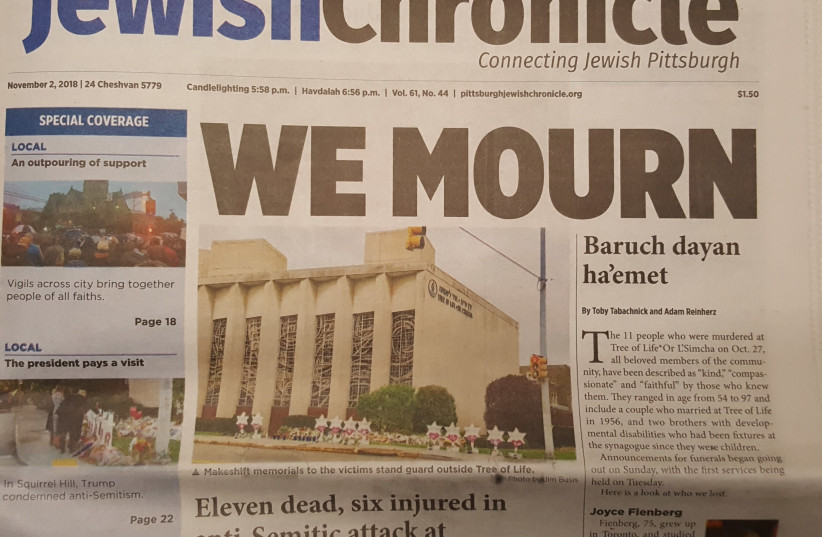 The cover of the Pittsburgh Jewish Chronicle regarding the Tree of Life shooting of October, 2018 (photo credit: JERUSALEM POST)