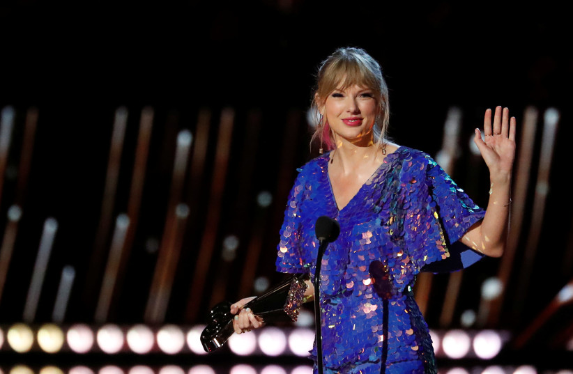 Singer Taylor Swift receives the Tour of the Year award during the iHeartRadio Music Awards in Los Angeles, California, U.S., March 14, 2019.  (photo credit: REUTERS/MARIO ANZUONI)