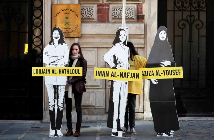 Demonstrators from Amnesty International stage the protest on International Women's day to urge Saudi authorities to release jailed women's rights activists Loujain al-Hathloul, Eman al-Nafjan and Aziza al-Yousef outside the Saudi Arabian Embassy in Paris, France, March 8, 2019 (photo credit: REUTERS/BENOIT TESSIER)