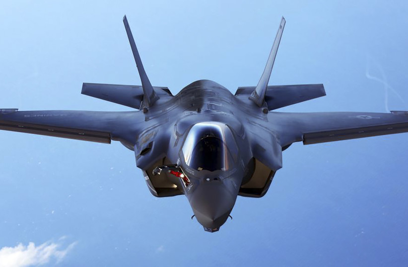 A U.S.Marine Corps F-35B joint strike fighter jet conducts aerial maneuvers during aerial refueling training over the Atlantic Ocean in this undated picture released August 20, 2015 (photo credit: REUTERS/US MARINE CORPS/HANDOUT)