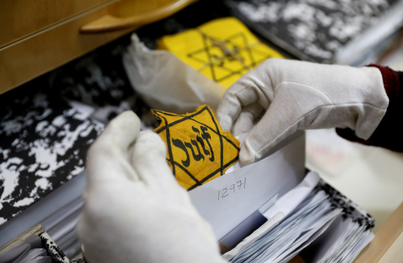An original yellow star (not on general display) is seen at the artifacts department of the Yad Vashem World Holocaust Remembrance Center in Jerusalem, ahead of the Israeli annual Holocaust Remembrance Day, April 10, 2018 (photo credit: REUTERS/Ronen Zvulun)