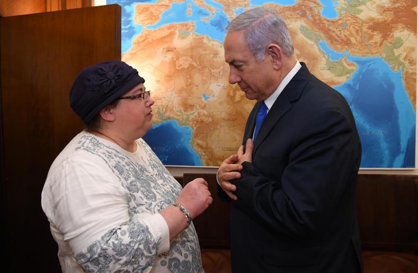Prime Minister Benjamin Netanyahu and Osna Baumel, sister of Zachary Baumel (photo credit: HAIM ZACH/GPO)