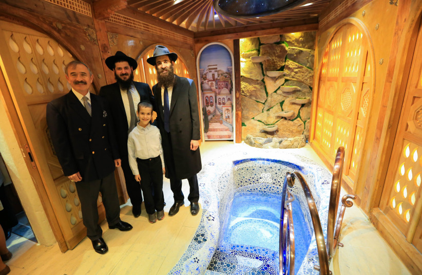Rabbi Osher Litzman and close ones stand beside the new $850,000 mikvah in South Korea, 2019. (photo credit: CHABAD OF SOUTH KOREA)