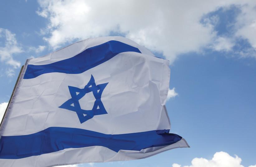 An Israeli flag [Ilustrative] (photo credit: MARC ISRAEL SELLEM/THE JERUSALEM POST)