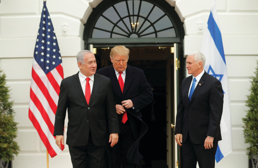 US PRESIDENT Donald Trump adjusts his jacket as he welcomes Prime Minister Benjamin Netanyahu with Vice President Mike Pence at the White House last month. Trump has dispelled any vestige of Palestinian trust in American intentions (photo credit: REUTERS/CARLOS BARRIA)