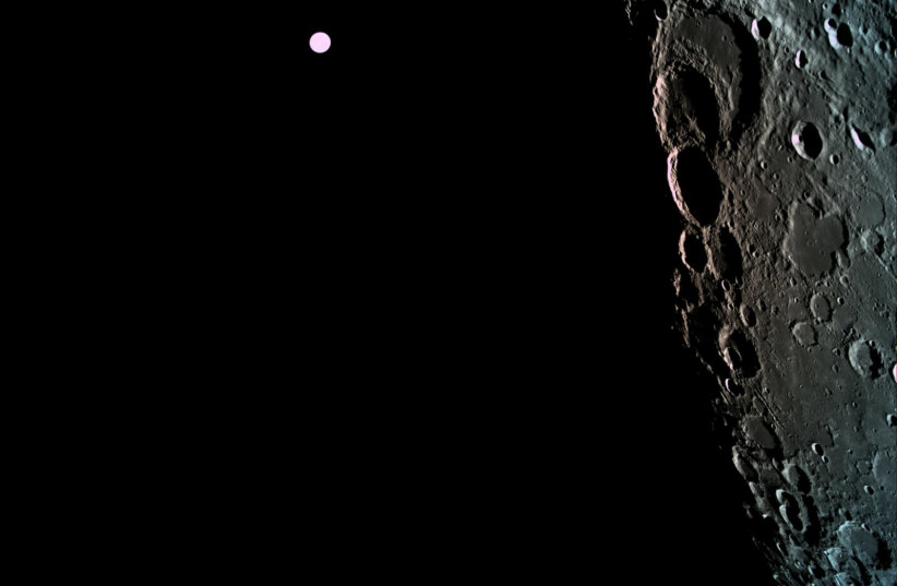 The surface of the moon as captured by Beresheet with the Earth in the background (photo credit: BERESHEET)