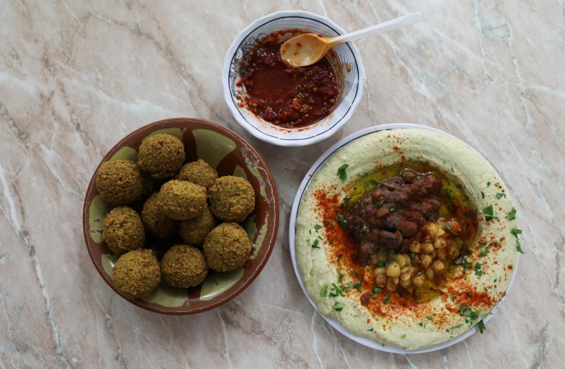 Chickpea-based hummus and falafel at the famed Abu Shukri restaurant in Jerusalem's Old City (photo credit: AMMAR AWAD / REUTERS)