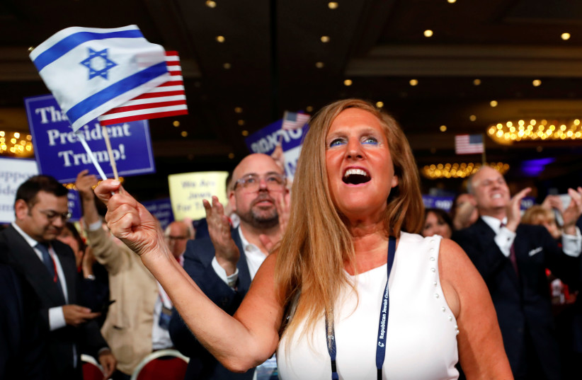 A supporter cheers as U.S. President Donald Trump addresses the Republican Jewish Coalition 2019 Annual Leadership Meeting in Las Vegas, Nevada, U.S., April 6, 2019 (photo credit: KEVIN LAMARQUE/REUTERS)
