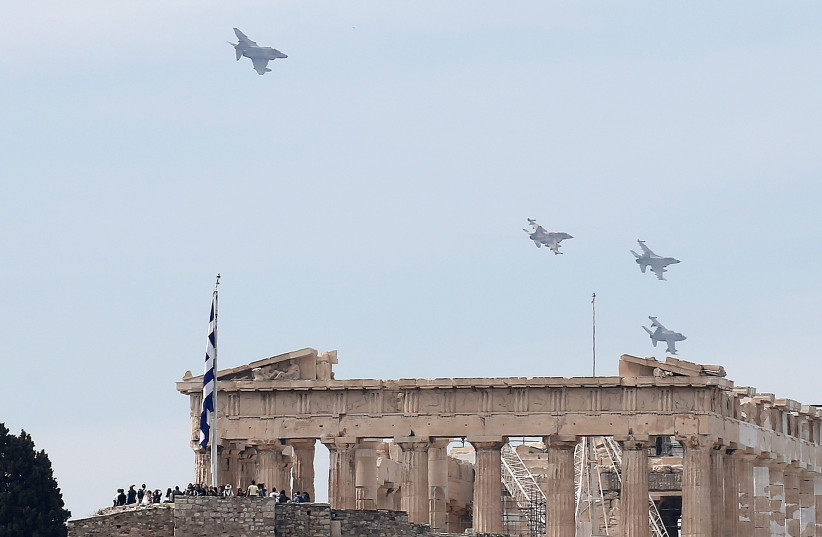 A formation of military fighting jets fly over the ancient Parthenon temple for a photo opportunity during the International Joint Medium Scale Air Force Exercise, in Athens, Greece April 4, 2017  (photo credit: REUTERS/ALKIS KONSTANTINIDIS)