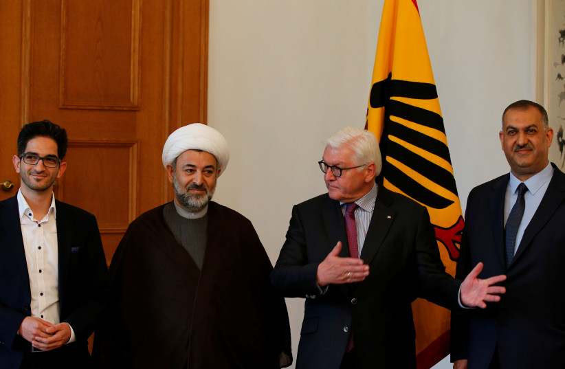 German President Frank-Walter Steinmeier welcomes Chairman of Islamic Community of Germany Sheikh Mahmood Khalilzadeh and Dawood Nazirizadeh, as he meets representatives of the Islamic communities of Shiites at Bellevue Palace in Berlin, Germany, April 30, 2018 (photo credit: REUTERS/AXEL SCHMIDT)
