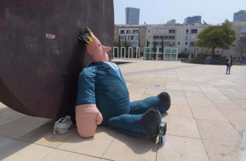 A life-sized doll of Prime Minister Benjamin Netanyahu sits in the middle of Habima Square in Tel Aviv on Sunday morning (photo credit: AVSHALOM SASSONI/MAARIV)