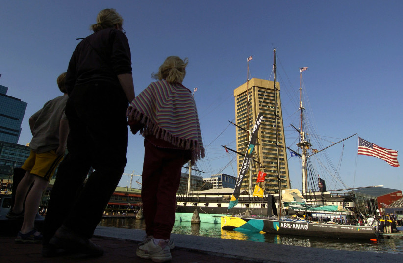 Visitors view ABN AMRO ONE at inner harbor in Baltimore after winning fifth leg of Volvo Ocean Race (photo credit: REUTERS)