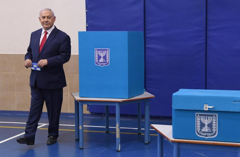 Prime Minister Benjamin Netanyahu voting at the elections (photo credit: HAIM ZACH/GPO)
