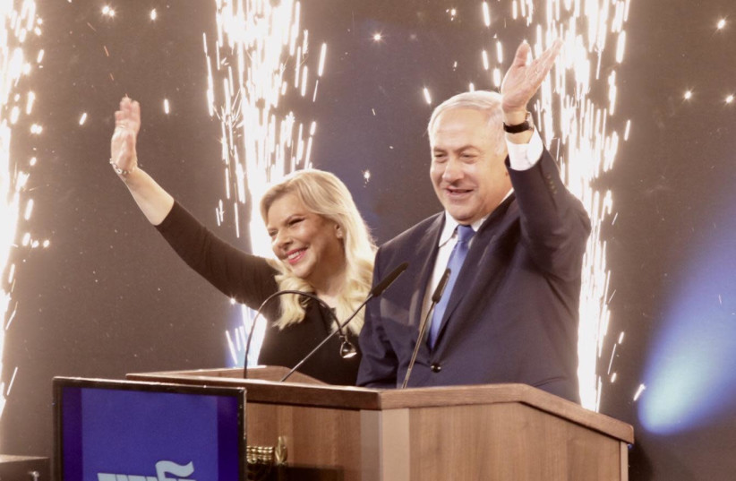 Prime Minister Benjamin Netanyahu and his wife declare victory (photo credit: ALONI MOR)