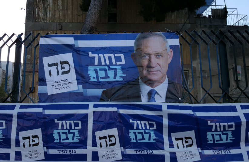 Campaign advertisements for Benny Gantz, chairman of the Blue and White party outside a polling station in Jerusalem, April 9, 2019 (photo credit: BEN BRESKY)