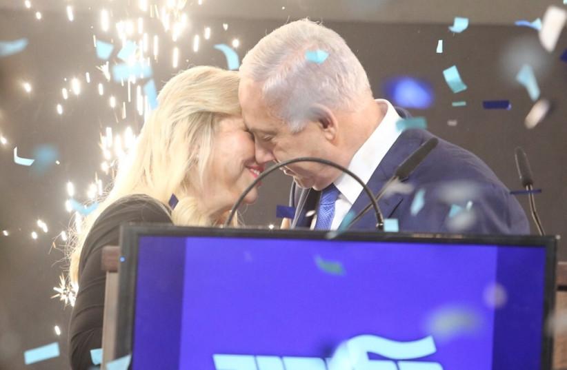Prime Minister Benjamin Netanyahu emraces his wife Sara after elections results, April 9th, 2019 (photo credit: MARC ISRAEL SELLEM/THE JERUSALEM POST)