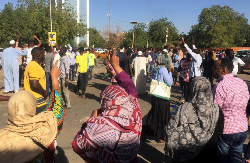 Sudanese demonstrators chant slogans during a protest demanding Sudanese President Omar Al-Bashir to step down in Khartoum, Sudan April 6, 2019 (photo credit: REUTERS/STRINGER)