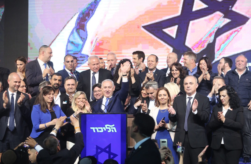 Likud Knesset members celebrate with Prime Minister Netanyahu and his wife after the elections. (photo credit: MARC ISRAEL SELLEM)