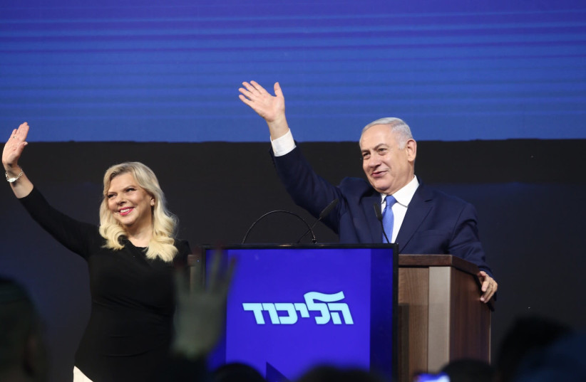 Prime Minister Netanyahu and his wife Sara greet supporters as Netanyahu at the Likud post-election celebration. (photo credit: MARC ISRAEL SELLEM)