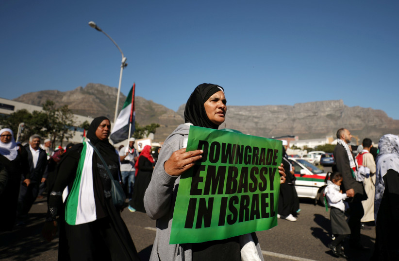 Protesters call for diplomatic ties between South Africa and Israel to be severed during a 2018 demonstration in Cape Town, South Africa. (photo credit: MIKE HUTCHINGS / REUTERS)