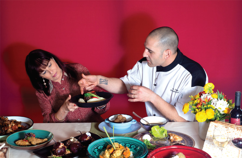 THE WRITER samples pre-Seder delights with chef Avi Cohen. (photo credit: YAFIT BASHEVKIN)